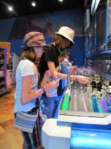 Rebecca and Michael in Tomorrow Land's build your own light saber bar... March 2011