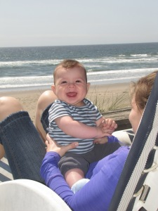 Baby Alonzo, sitting on Kalisha's lap, loves the ocean view.