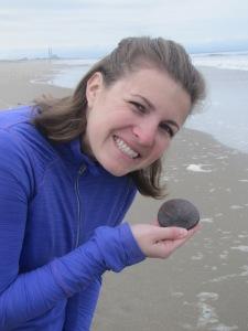 Kalisha rescues a live sand dollar