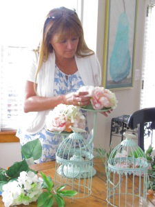 Me working on some of the wedding decor!  The colors were mint, blush, and apricot.