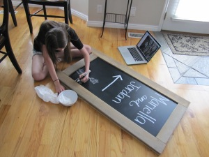 Rebecca adds some flair to the chalkboard sign.  She's so artistic!