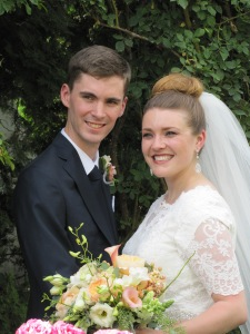 Newlyweds in the rose garden
